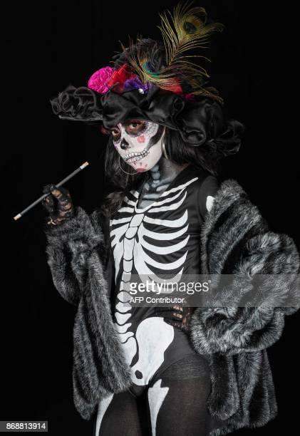 Student Itzel Yuritzi Farías poses for a photograph disguised as Catrina during a Catrina competition at the University of Michoacan in Morelia...