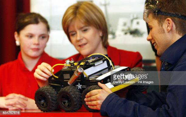 Student Jennifer Fraser 14 Deputy First Minister Nicola Sturgeon and actor Will Roberts look at a fake UAV during the launch of the Scottish leg of...