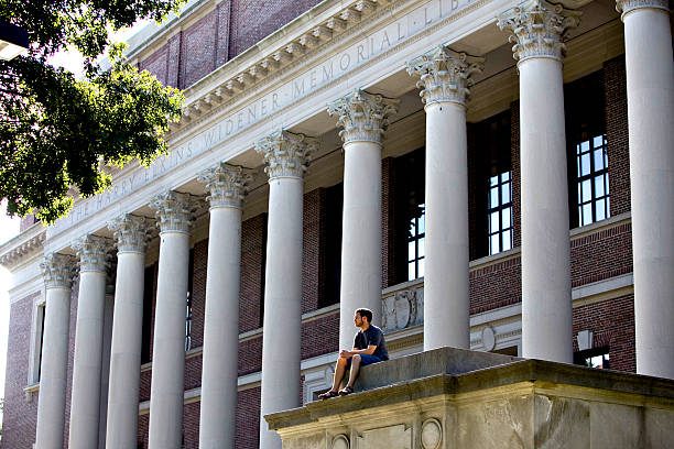 Student Jonathan Warsh Sits Outside The Widener Library On T