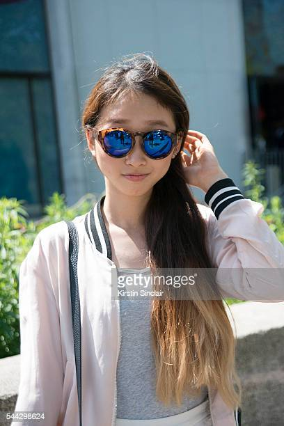 Student Joy Sin wears a Forever 21 bag and sunglasses and a Bershka jacket on day 2 of Paris Collections Men on June 23 2016 in Paris France Joy Sin