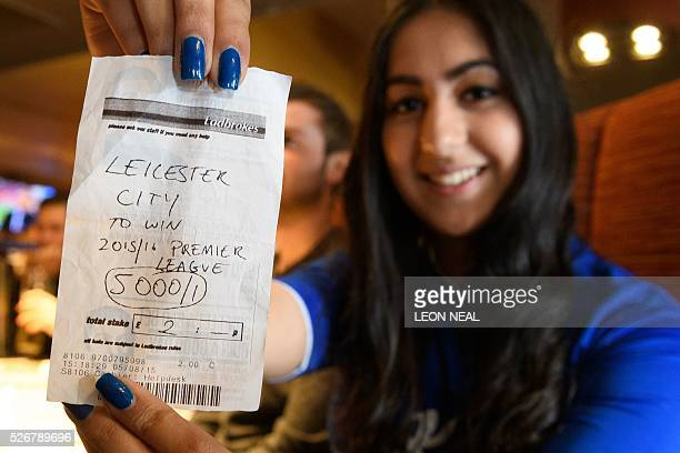 Student Karishma Kapoor holds her betting slip with odds of 5000/1 if Leicester City win the Premiership title ahead of watching the Leicester City...