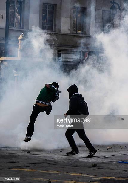 Student kicks a smoke bomb