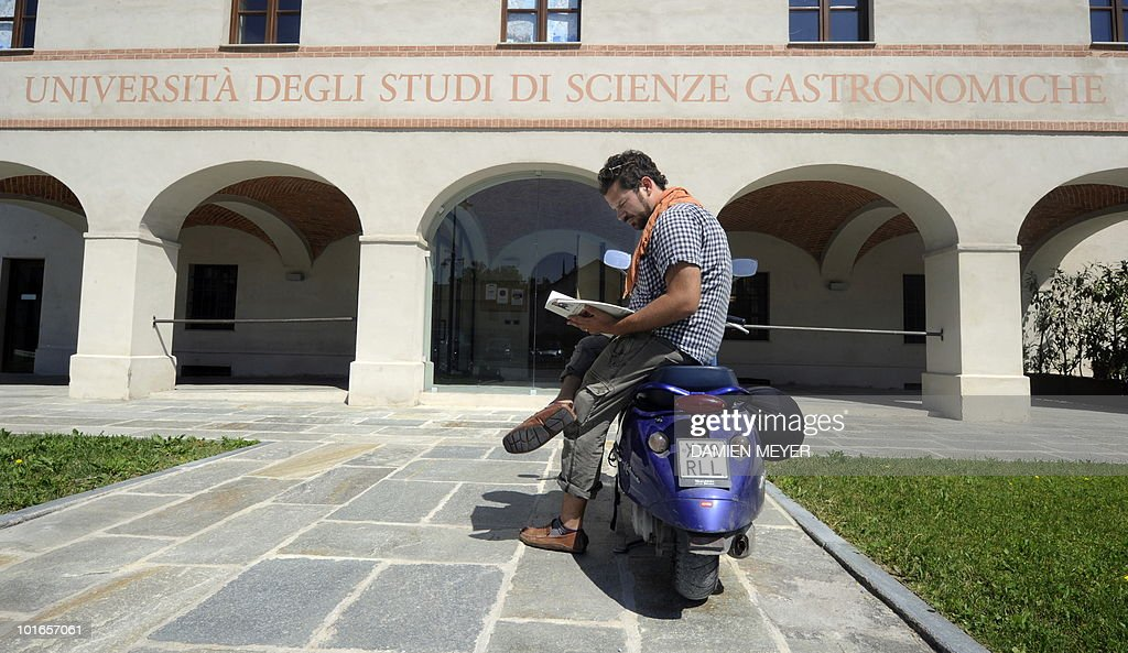 US student, Laine Steelman from California, reads a book in front of the Gastronomic Science University in Bra (40km south of Turin), on May 31, 2010. Established in 2004, this university based on 'Slowfood' concepts against standardization of the taste and for respectful environment gastronomy, forms gastronoms, but not chiefs.