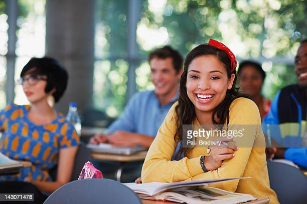 student laughing at desk in classroom - learning objectives stock pictures, royalty-free photos & images