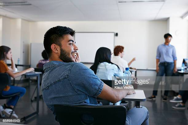 Student laughing in classroom