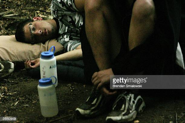 A student lays down while camping out at the Center for Attention and Related Disorders camp at the Great Hollow Wilderness School July 30 2003 in...