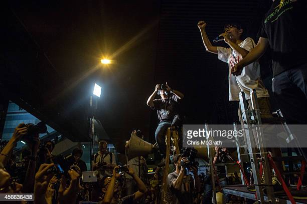 Student leader Joshua Wong speaks to protesters on October 4, 2014 in Hong Kong, Hong Kong. Thousands of pro democracy supporters continue to occupy...