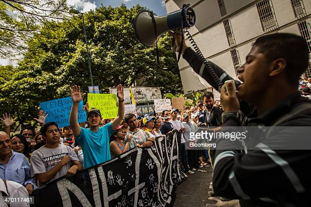 A student leader with a bullhorn leads a crowd in chanting slogans during a demonstration in Caracas Venezuela on Monday Feb 17 2014 Venezuela's...