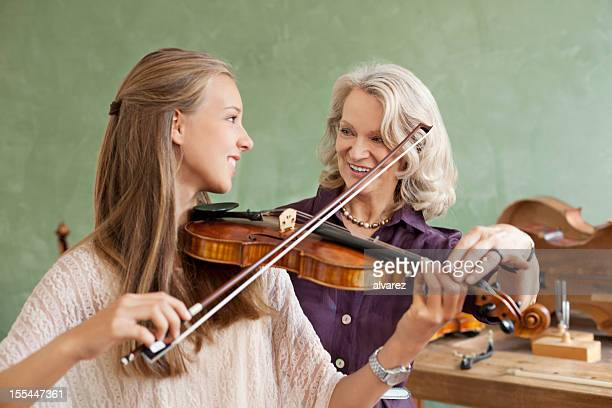 Student learning how to play violin