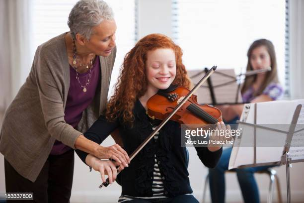 Student learning to play the violin