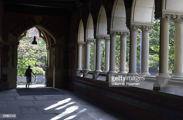 A student leaves Harvard's Memorial Hall on October 10 2003 in Cambridge Massachusetts