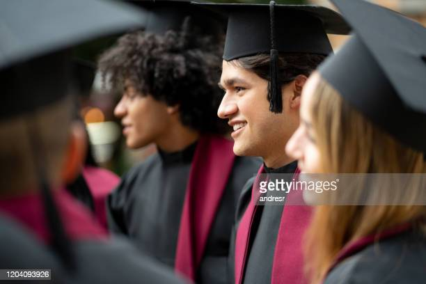 student looking happy on his graduation day - alumni stock pictures, royalty-free photos & images