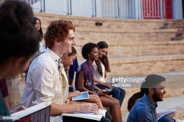 Student looking out & smiling in auditorium