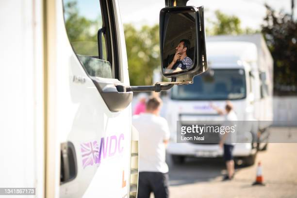 Student looks on from the cab of an HGV lorry as another man takes part in a driving lesson at the NDC heavy goods vehicle training centre on...