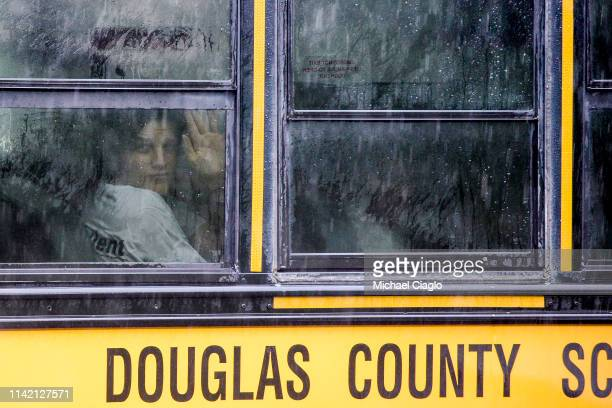 A student looks out of a bus transporting students to the Recreation Center at Northridge after at least seven students were injured during a...