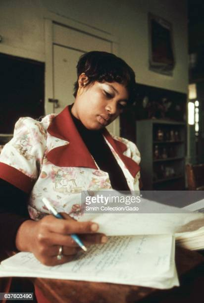 A student looks over her classwork for a Black Studies history class at a school in the West Side of Chicago Illinois October 1973 Image courtesy...
