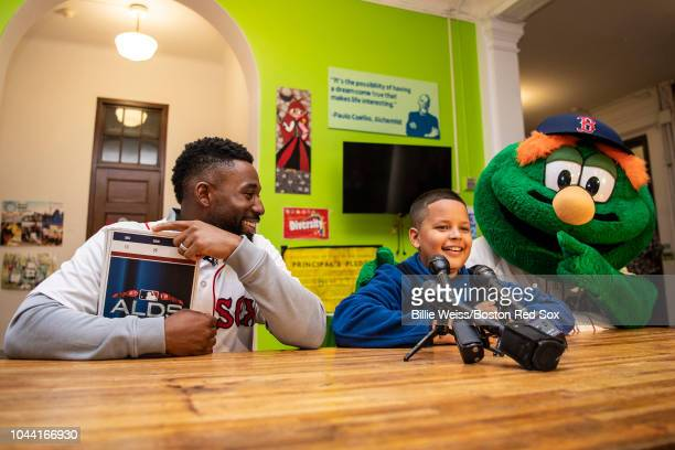 Student Lucas Feliciano speaks with the media after Jackie Bradley Jr #19 of the Boston Red Sox and mascot Wally the Green Monster surprised him with...