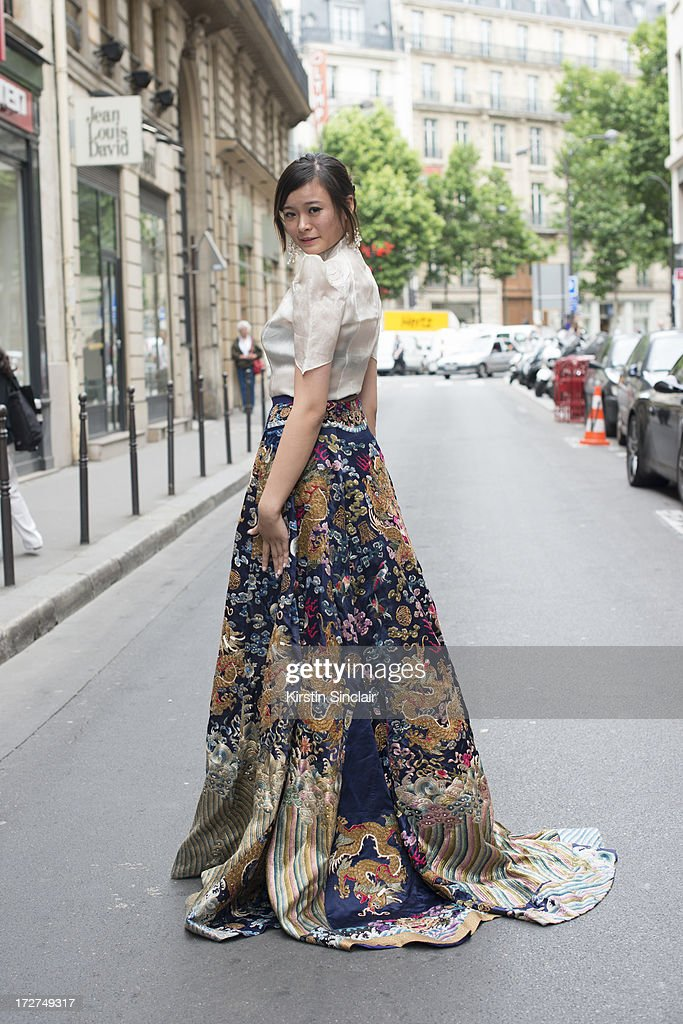 Student Maggie Guo wears a Lawrence Xu Skirt and Top on day 4 of Paris Collections: Womens Haute Couture on July 04, 2013 in Paris, France.