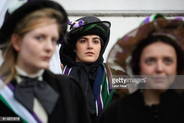 Student Mahta Ameli listens to a speech as a group recreates a protest march through the town centre at Royal Holloway University of London on...