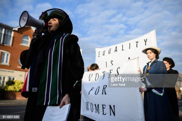 Student Mahta Ameli performs a speech originally delivered by suffragette Emmeline Pankhurst as they recreate a protest march through the town centre...