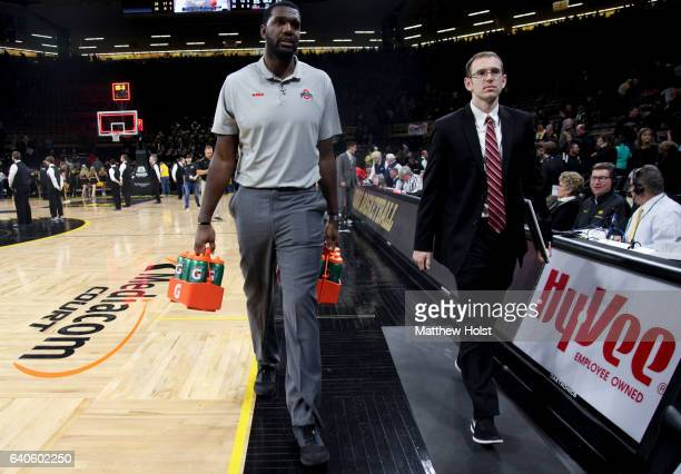 Student manager Greg Oden of the Ohio State Buckeyes carries water bottles off the court following the matchup against the Iowa Hawkeyes on January...