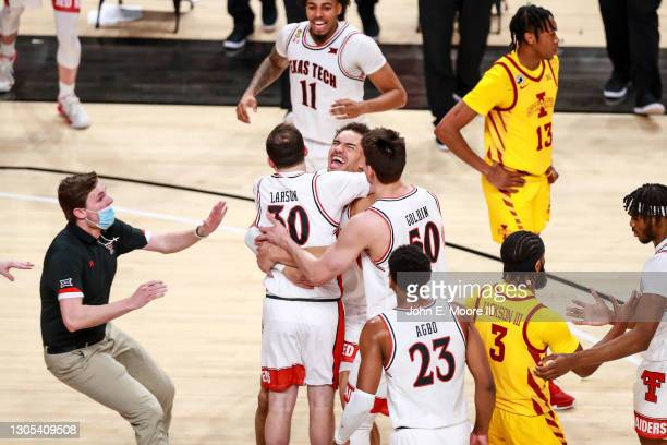 Student manager Ty Larson of the Texas Tech Red Raiders celebrates with forward Marcus Santos-Silva following a win against the Iowa State Cyclones...