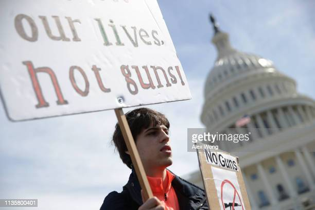 Student Maximilian Steubl of Churchill High School in Potomac Maryland participates in a gun control rally at the West Front of the US Capitol March...