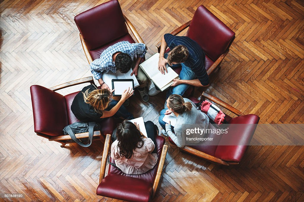 Student meeting in library - Teamwork : Stock Photo