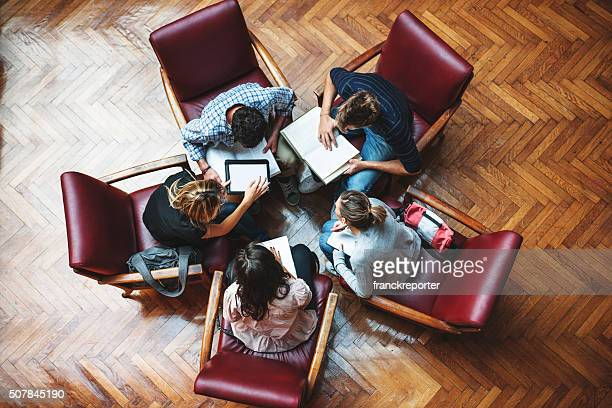 student meeting in library - teamwork - small group of people stock pictures, royalty-free photos & images