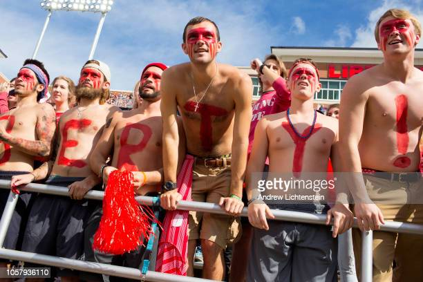 Student members of the club known as Jerry's Jokers at Liberty University cheer on the home football team on October 20 2018 in Lynchburg Virginia...