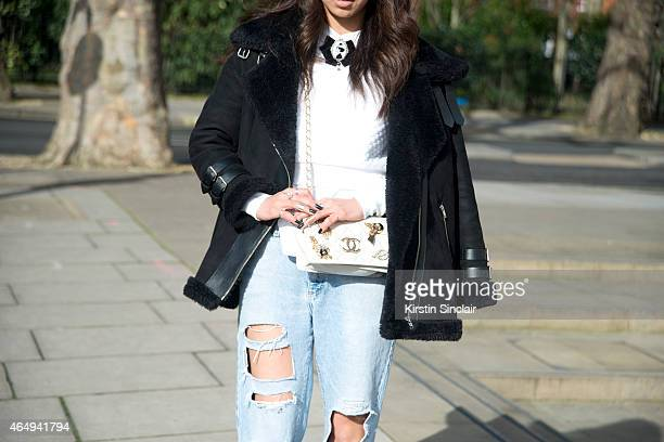 Student Mirai Song wears a H and M top jeans she made her self headband from Japan jacket from Korea and a customised vintage Chanel bag on February...