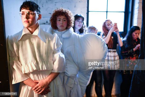 Student models backstage during the Fashion Design and Textile Design catwalk show at the Vic in the Glasgow School of Art on March 12 2019 in...
