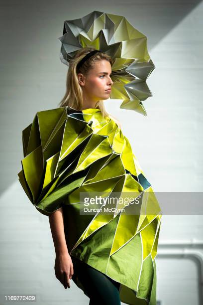 Student models display clothes ahead of the Fashion Design and Textile Design catwalk show at Glasgow School of Art on August 23 2019 in Glasgow...