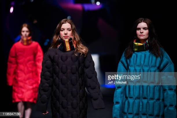 Student models display clothes during the Fashion Design and Textile Design catwalk show at the Vic in the Glasgow School of Art on March 12 2019 in...