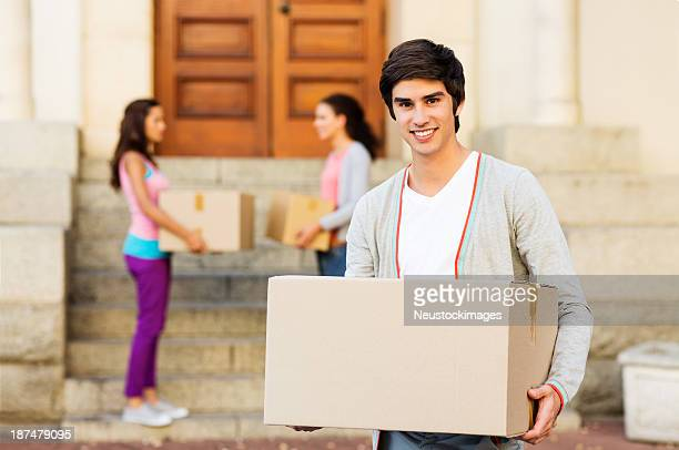 Student Moving Into New College Dorm