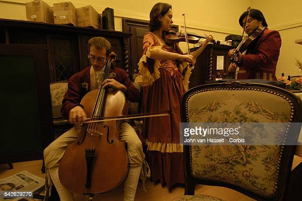 Student musicians from Mozarteum University warm up before playing Mozart at the historic Baroque hall in the Stiftskeller Saint Peter restaurant One...