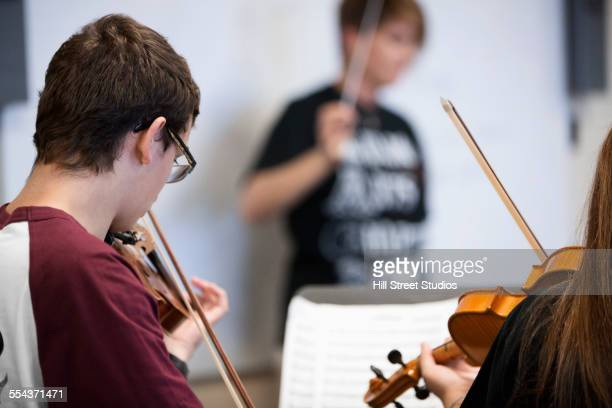 student musicians playing violins - musical quartet stock photos and pictures