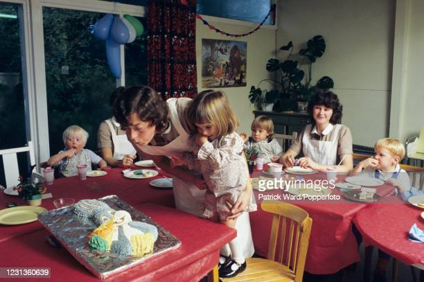 Student nannies organising a birthday party at Norland College, Denford Park near Hungerford in Berkshire, circa 1991. The Norland Institute, which...