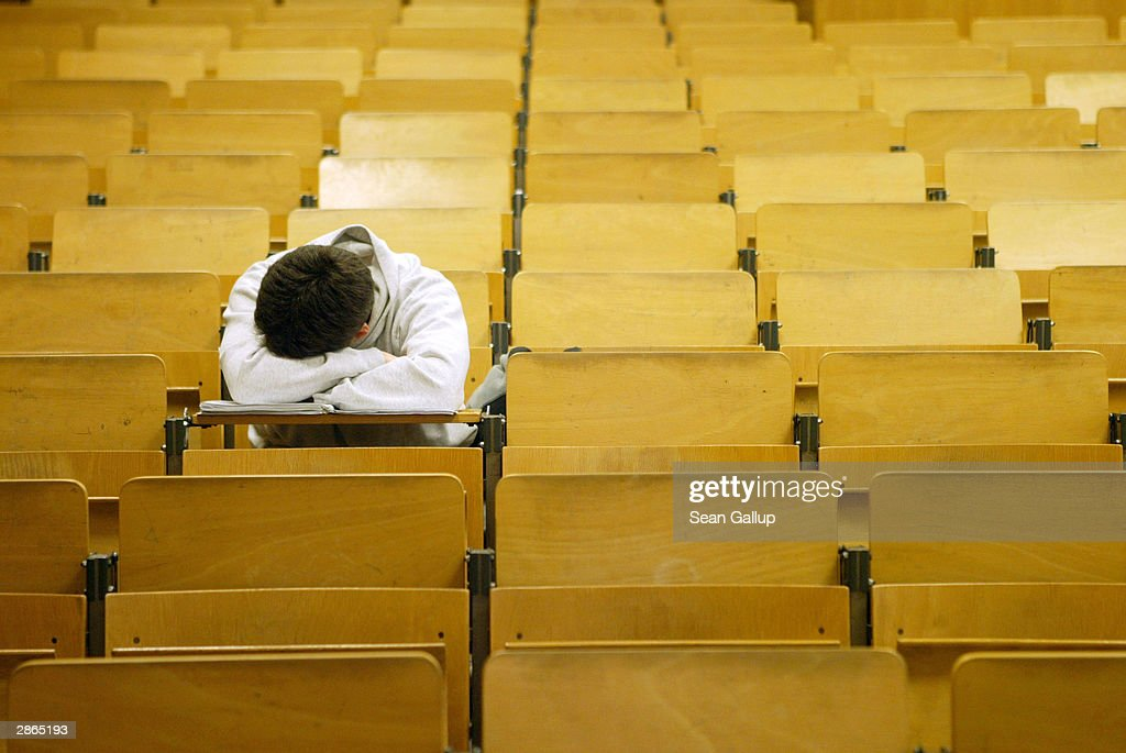 A student naps in a lecture hall at the Freie Universitaet January 13, 2003 in Berlin, Germany. The German university system is facing cuts of EUR 75 million in state funding over the next four years as the German government pushes through financial reforms. German politicians are also deliberating whether to start making students pay for at least a portion of the costs of their university education, though the proposal has met with fierce resitance from students, who went on strike across Germany last month.