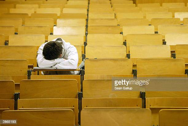 A student naps in a lecture hall at the Freie Universitaet January 13 2003 in Berlin Germany The German university system is facing cuts of EUR 75...