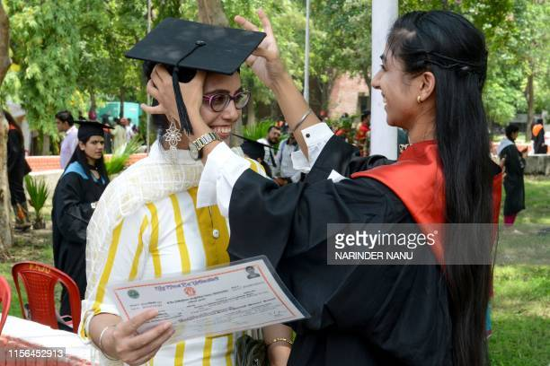 Student Navjot Kaur puts a graduation cap on her mother after she received her BTech degree during the Golden Jubilee Year Convocation at the Guru...