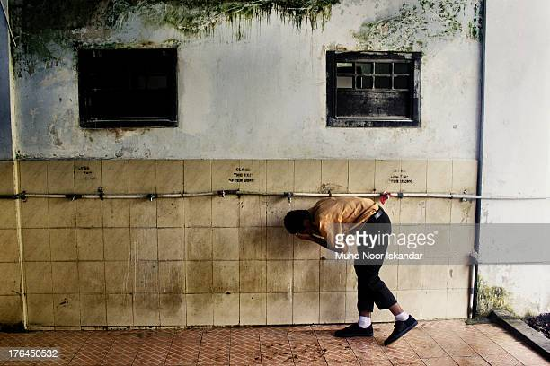 Student of a boarding school performing ablution.