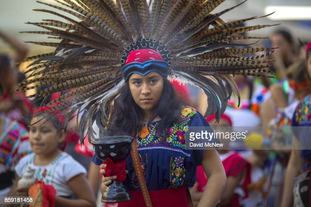 A student of Anahuacalmecac International University Preparatory of North America school for indigenous students holds incense during an event...
