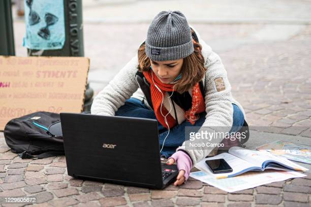 Student of high school Gioberti follows a distance learning lesson on the street outside her school to protest against schools closures imposed by...
