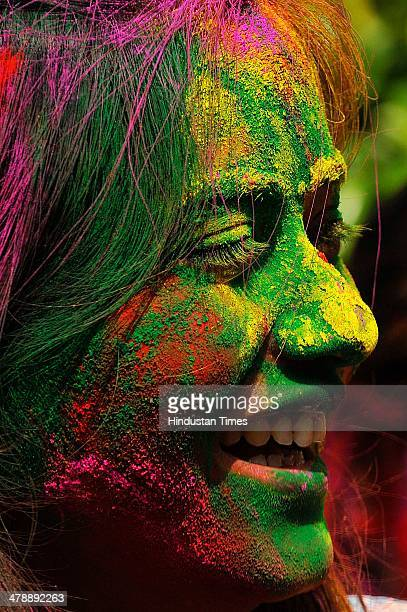 A student of Institute of Management Studies playing holi with each other before the Holi festival on March 15 2014 in Noida India Holi is a festival...