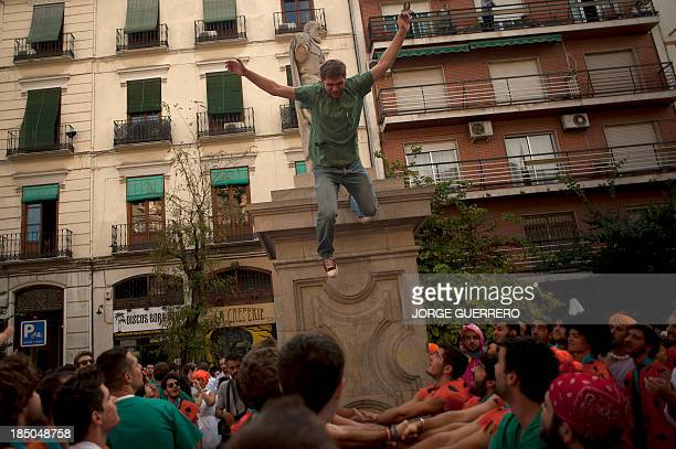 A student of the Faculty of Medicine jumps during a hazing at the University of Granada in Granada on October 17 2013 AFP PHOTO/ JORGE GUERRERO
