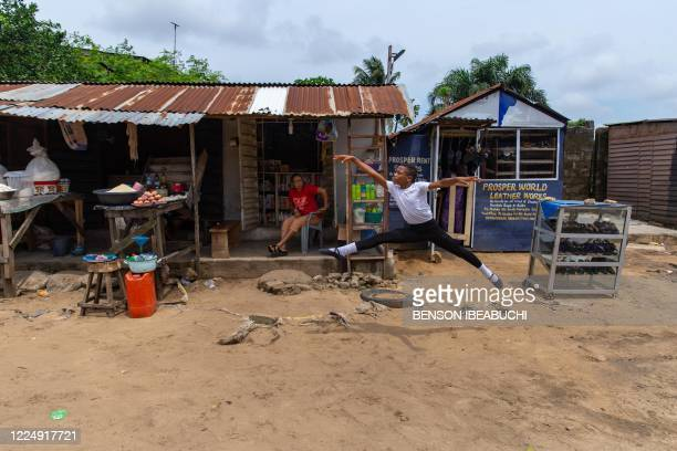 Student of the Leap of Dance Academy, Anthony Madu , performs a ballet dance routine in front of his mother's shop in Okelola street in Ajangbadi,...