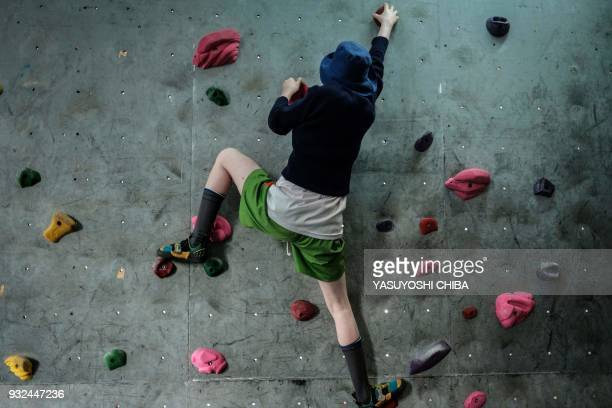 A student of Thika school for the Blind challenges bouldering on the artificial climbing wall during a weeklong free climbing training for visually...