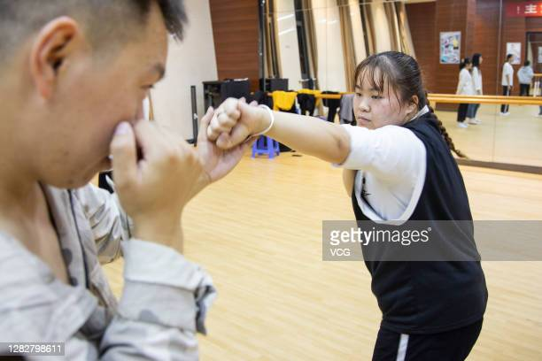 Student of Zhenjiang College practises straight punch during a weight-loss lesson on October 28, 2020 in Zhenjiang, Jiangsu Province of China.