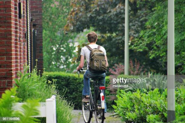 student on bicycle - 18 19 years stock pictures, royalty-free photos & images